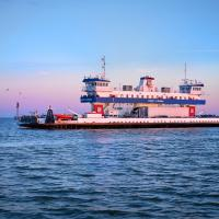Galveston Ferry at dusk by eleanorbrown