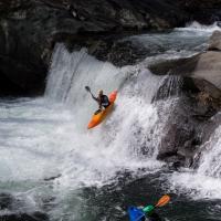 Baby Falls Kayak Spectators by Mark Gowin