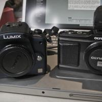 Camera Pic - G1 And E-p21 Of 1 by woodmancy