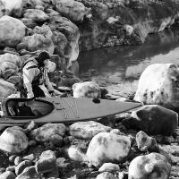 Kayaker And Sea Ice by bensonga in bensonga